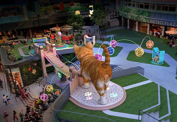 空中花園以七彩布幕裝飾,配以炫彩光影燈效,貓奴帶著主子來到散步,享受浪漫時刻!